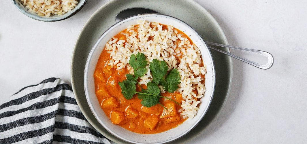 Creamy pumpkin curry soup with rice